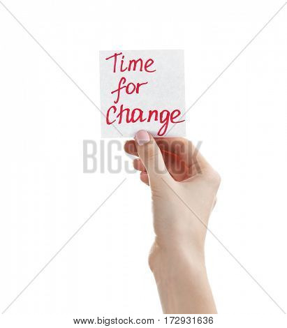 Female hand holding note with phrase TIME FOR CHANGE on white background