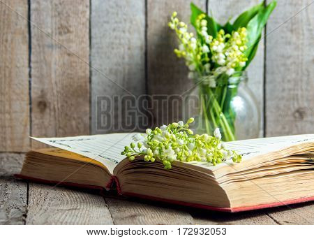Open Book With Lily Of The Valley Flower