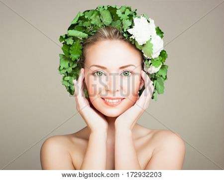 Smiling Woman Spa Model with Clear Skin Green Eyes and Wreath of Oak Leaves