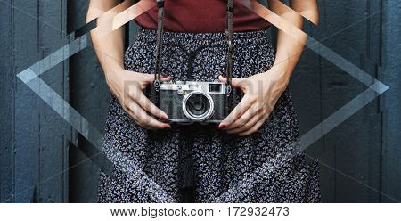 Traveler photographer woman holding film camera