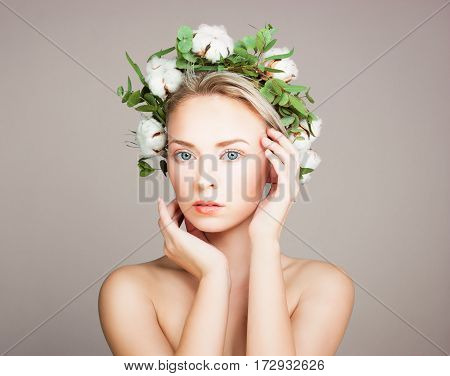 Perfect Model Woman with Healthy Skin and Cotton Flowers. Cosmetology and Herbal Treatment Concept
