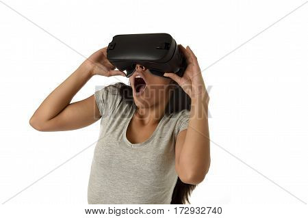 young attractive happy woman excited using 3d goggles watching 360 virtual reality vision enjoying cyber fun experience in vr simulation reality and new gaming technology isolated white background