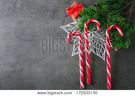 Christmas candy canes on grey textured background