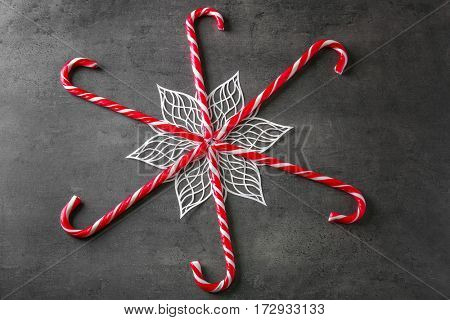 Sweet candy canes on grey textured background
