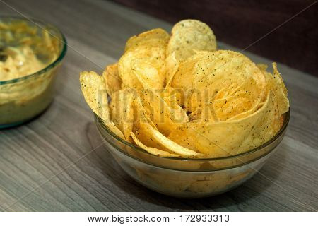 bowl of potato chips and cheese sauce