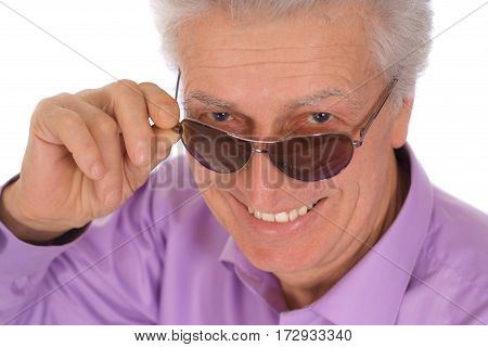 Attractive middle-aged man with sunglasses on a white background