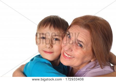 little boy with his grandmother on a white background