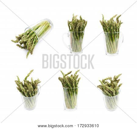 Glass filled with the multiple cultivated green asparagus spears isolated over the white background, set of six different foreshortenings