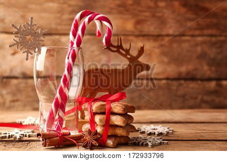 Christmas decoration with candy canes on wooden background