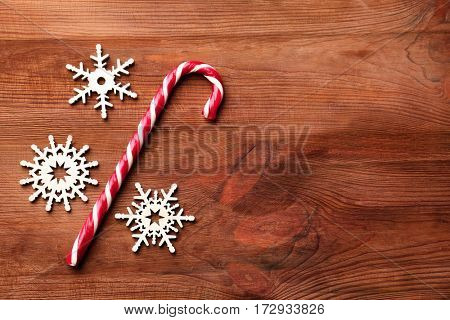 Christmas decoration with candy cane on wooden background