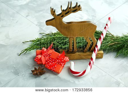 Christmas composition with candy cane and decorations on textured background