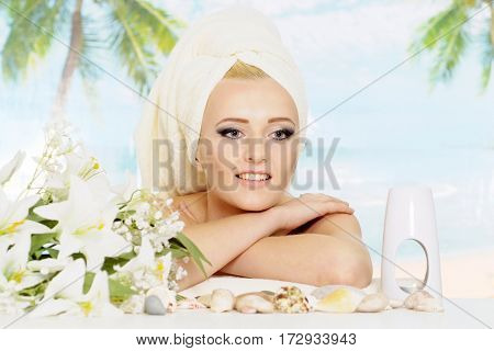 Amusing blonde with a bright appearance is resting at a resort