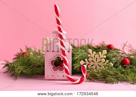 Christmas decoration with candy cane on pink background