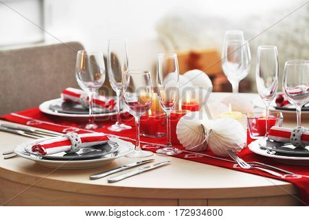 Table served for Christmas dinner in living room, closeup view