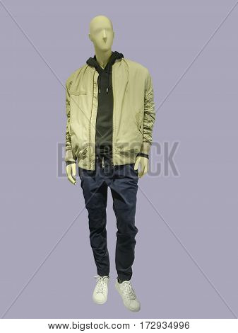 Full-length male mannequin dressed in sportswear isolated. No brand names or copyright objects.