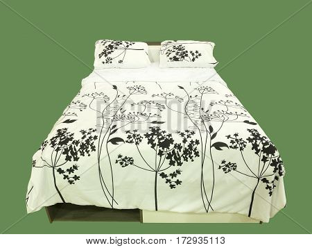 Modern wooden bed with white pillows and blanket over green background.