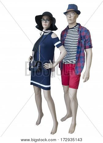 Two mannequins male and female dressed in fashionable summer clothes isolated on white background.