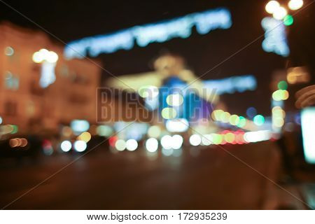 Decorated city at Christmas night, blurred background