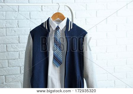 School uniform of teenage boy on hanger