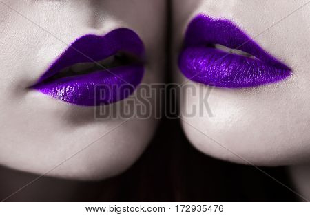 Female lips with violet blueberry matte lipstick closeup. Macro photo of lips. Girls lesbians, Blue lips