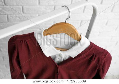 School uniform of teenage girl on hanger