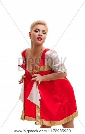 Pretty blonde with sexy short hair cut in unbuttoned short russian national dress posing in studio