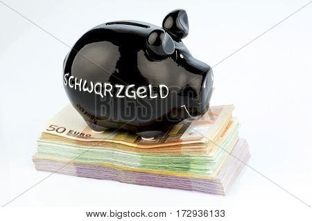 black piggy bank on money