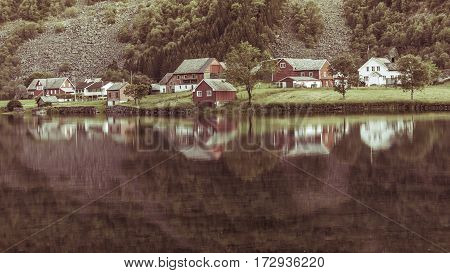 Norwegian Country Houses In The Mountains On Lake Shore