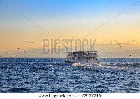 Boat sailing in bosphorus in Istanbul during sunrise