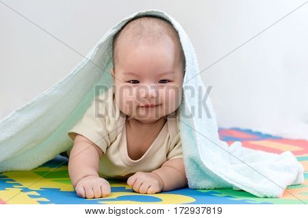 Portrait Of A Little Adorable Newborn Infant Baby Girl With Blanket Lying On The Tummy On Colorful E