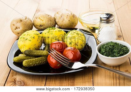 Baked Potatoes, Pickled Gherkins And Tomatoes, Greens, Bowl With Oil