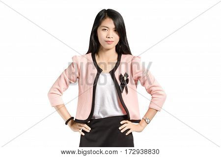 Portrait of a beautiful asian business woman akimbo in pink blazer and black skirt. Isolated on white background