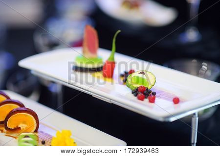 Molecular Modern Cuisine. Various Fancy Dishes On White Plates In A Restaurant.