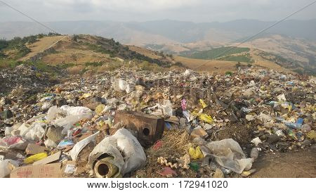 Uncontrolled waste landfill site / dumpsite in the mountains