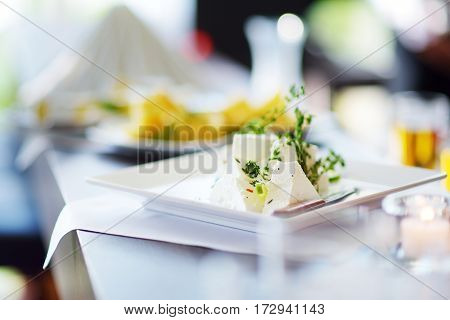 Different Kinds Of Wine Snacks And Variuos Cheeses On White Table