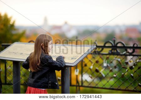 Cute Little Girl Enjoying A View Of Vilnius City On Autumn Day