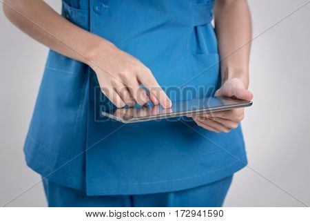 Medical Doctor Using Tablet.