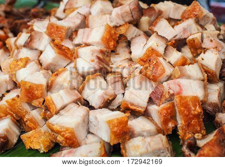 Deep fried pork belly (Crispy pork) placed on a banana leaf, Selective focus and Close up