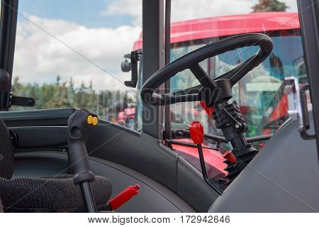Steering wheel and levers in the cab closeup. Industry