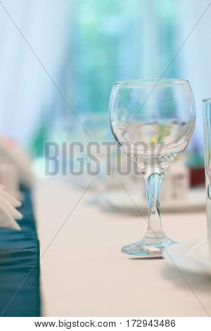 Closeup image of empty stemware standing on a table