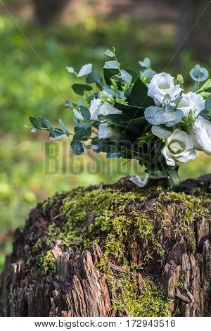 Wedding Bouquet Of White Flowers On The Wood Stump Outdoors