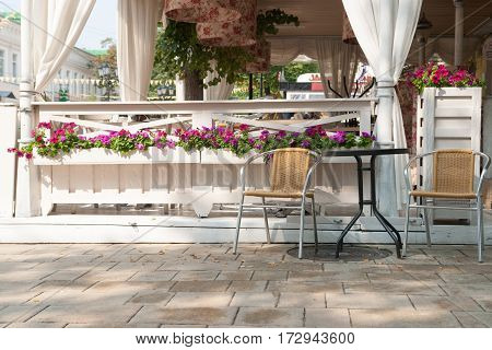 Empty Tables And Chairs On Restaurant Or Cafe