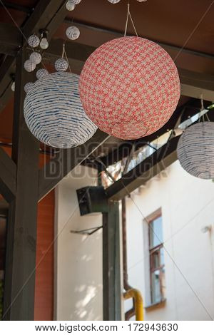 Red Paper chandelier on street restaurant in Europe