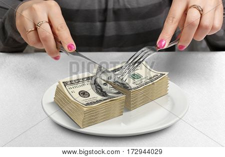 Cut money on plate cut budget concept