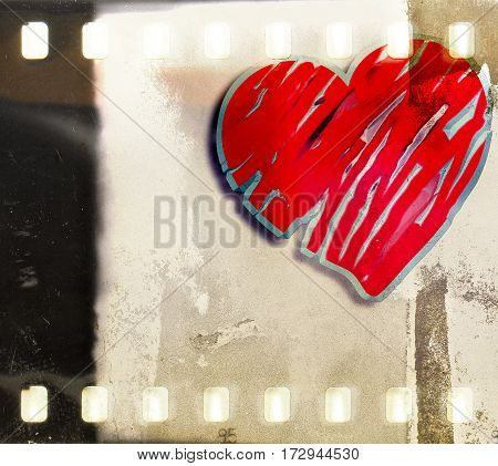 Vintage film strip frame with single heart. Valentines Day concept.