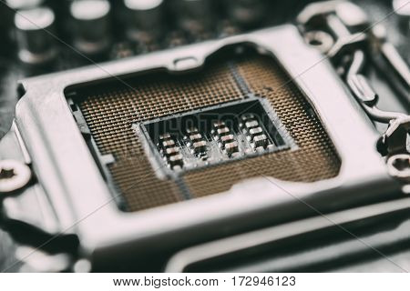 Socket for processor or cpu, macro photo. Electronic computer hardware technology. Motherboard digital chip. Tech science background. Blurred and toned image.