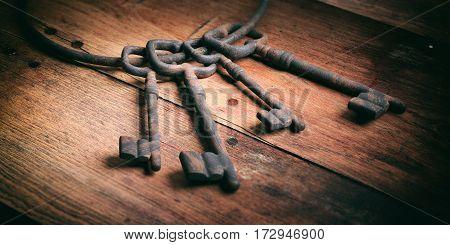 Old Keys Bunch On A Wooden Background. 3D Illustration