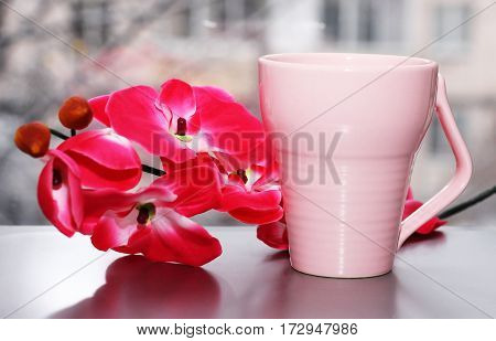 A cup of tea and a beautiful orchid foot