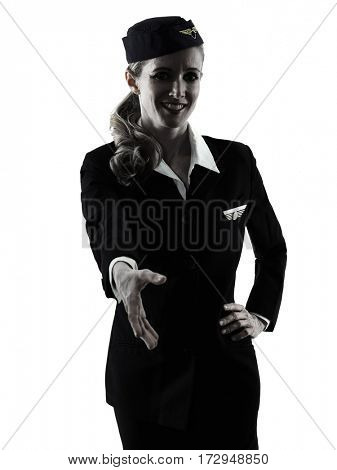 one caucasian Stewardess cabin crew  woman Handshaking isolated on white background in  silhouette