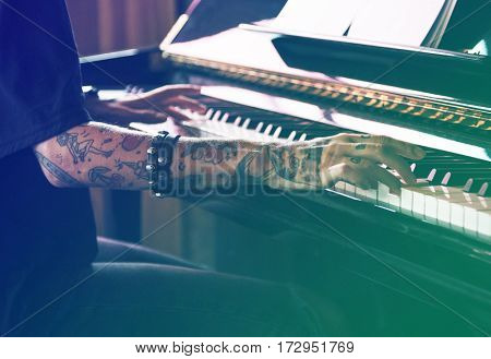 Musician playing piano practice and perform